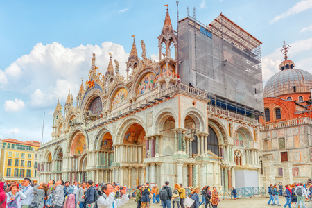 VENICE, ITALY - MAY 11, 2017 : Square of the Holy Mark (Piazza San Marco) and St. Marks Cathedral (Basilica di San Marco) with tourists. Italy. Editorial