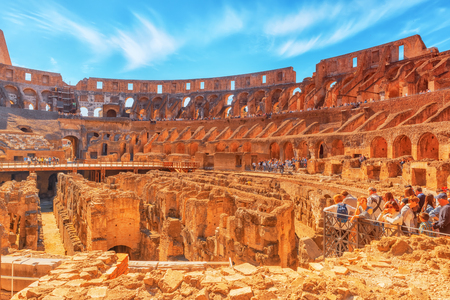 rostrum: ROME, ITALY - MAY 08, 2017 : Tourists Inside the amphitheater of Coliseum in Rome- one of wonders of the world  in the morning time. Editorial