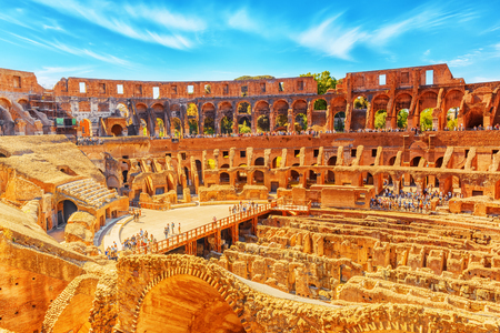 ROME, ITALY - MAY 08, 2017 : Tourists Inside the amphitheater of Coliseum in Rome- one of wonders of the world  in the morning time. Editorial
