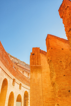 Inside the amphitheater of Coliseum in Rome- one of wonders of the world  in the morning time. Stock Photo