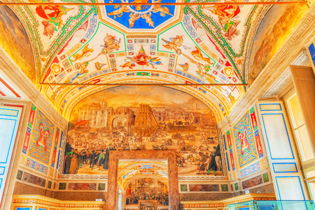 VATICAN-CITY, VATICAN - MAY 09, 2017: Inside the Vatican Museum, one of the largest museums in the world, Vatican Galleries frescoes. Italy.