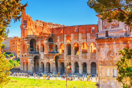 ROME, ITALY - MAY 08, 2017 : Beautiful landscape of the Colosseum in Rome- one of wonders of the world  in the morning time with tourists near him. Stock Photo