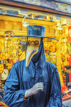 VENICE, ITALY - MAY 11, 2017 : Plague doctor costume was a medical physician who treated victims of the plague. They were specifically hired by towns that had many plague victims in times of epidemics. Venice. Italy.