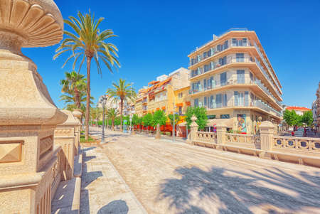 Sitges, Spain - June 14, 2017 : View of the embankment and the promenade in small resort town-Sitges in the suburbs of Barcelona.