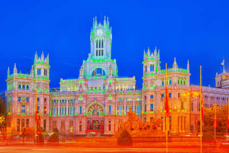Madrid, Spain - June 05, 2017: Fountain of the Goddess Cibeles (Fuente de La Diosa Cibeles) and Cibeles Center or  Palace of Communication, Culture and Citizenship Centre in the Cibeles Square of Madrid (Plaza Cibeles). Editorial
