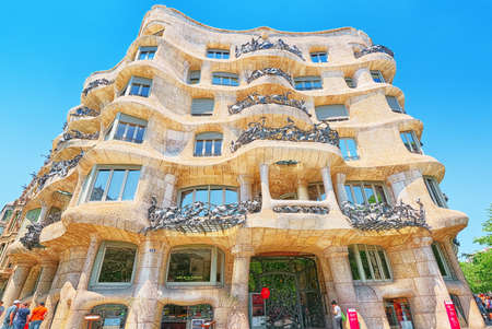 Barcelona, Spain - June 12, 2017 : Casa Mila  popularly known as La Pedrera or open quarry, a reference to its unconventional rough-hewn appearance, is a modernist building in Barcelona.