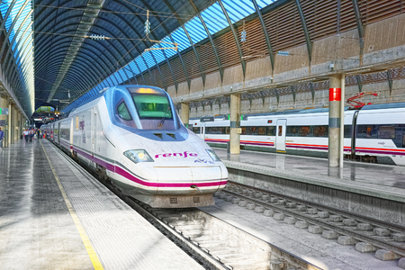 Seville, Spain - June 10, 2017 : Modern hi-speed passenger train of Spanish railways company-Renfe, on Seville railways station Sevilla Santa Justa.