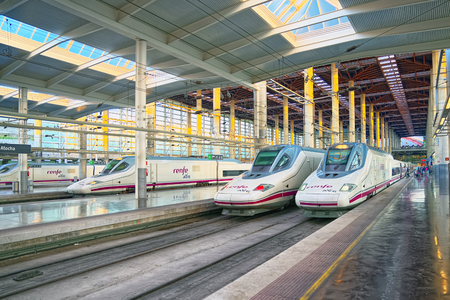 Madrid, Spain - June 08, 2017 : Modern hi-speed passenger train of Spanish railways company-Renfe, on Madrid railways station Puerta de Atocha. Editorial