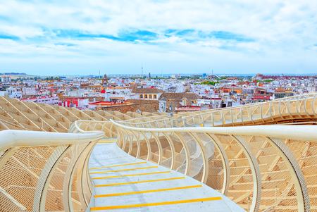 Seville, Spain - June 08,2017: Panoramic view of the city of Seville from the observation platform Metropol Parasol, locally also known as Las Setas. Spain. Redakční