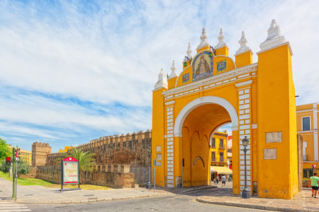 Seville, Spain- June 08, 2017 : Arco de la Macarena on Wall of Seville (Muralla almohade de Sevilla) are a series of defensive walls surrounding the Old Town of Seville. The city has been surrounded by walls since the Roman period. Editorial
