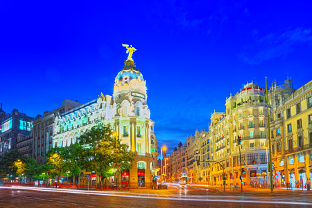 Madrid, Spain - June 04, 2017 : Gran Via Street in Madrid, after sunset, traffic lights on Gran Via, main shopping and  financial street in Madrid at night.