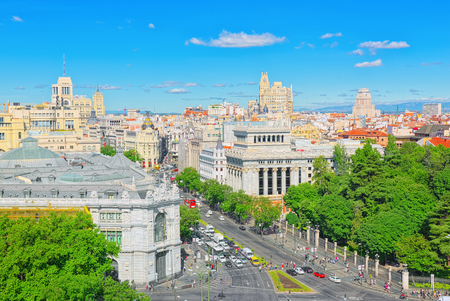 Madrid, Spain - June 06, 2017 :View above on Gran Via Street in Madrid, at day time, traffic, car on Gran Via street, main shopping and  financial street in capital of Spain. Madrid.