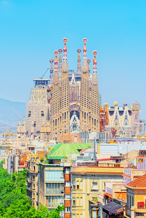 Barcelona, Spain - June 12, 2017: Basilica of La Sagrada Familia against blue sky. Most amazing and fabulous creations of the great architect Antoni Gaudi, construction has began in 1882 and is not fi