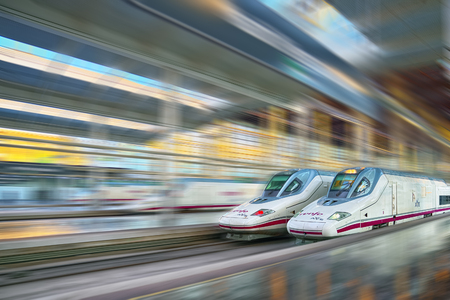 Madrid, Spain - June 08, 2017 : Modern hi-speed passenger train of Spanish Railways Company - Renfe, in  movement (motion).