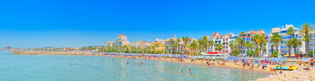 Sitges, Spain - June 14, 2017 : View of the beach and the sea shore of a small resort town Sitges in the suburbs of Barcelona.