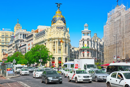 Madrid, Spain - June 05, 2017 : Gran Via Street in Madrid,at day time, traffic, car on Gran Via street, main shopping and  financial street in capital of Spain.