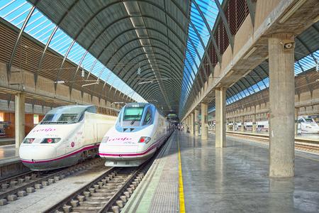 Seville, Spain - June 08, 2017 : Modern hi-speed passenger train of Spanish railways company-Renfe, on Seville railways station Sevilla Santa Justa.