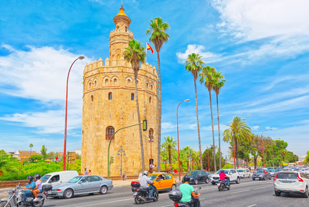 Seville, Spain - June 09, 2017 : Tower of Gold (Torre del Oro) is a dodecagonal military watchtower on Paseo de Cristobal Colon in Seville. 에디토리얼