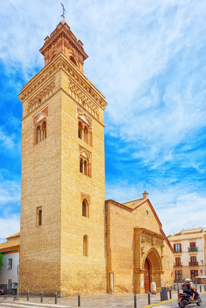 Seville, Spain - June 08,2017: Iglesia de San Marcos (Church of San Marcos) on St. Mark's Square (Plaza San Marcos) in downtown of the city Seville. Spain.