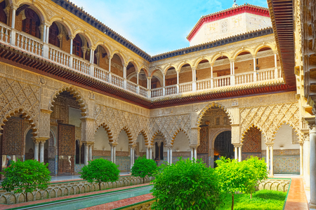 Seville, Spain - June 09, 2017 : Panoramic view of inner patio- Maidens Courtyard ( Patio De Las Doncellas) of the Royal Alcazar in Seville.