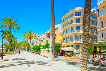Sitges, Spain - June 14, 2017 : View of the embankment and the promenade in small resort town-Sitges in the suburbs of Barcelona. Spain.