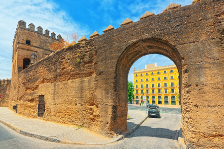 Seville, Spain- June 08, 2017 : Wall of Seville (Muralla almohade de Sevilla) are a series of defensive walls surrounding the Old Town of Seville. The city has been surrounded by walls since the Roman period. Editorial