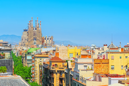 Barcelona, Spain - June 12, 2017: Basilica of La Sagrada Familia against blue sky. Most amazing and fabulous creations of the great architect Antoni Gaudi, construction has began in 1882 and is not finished yet.