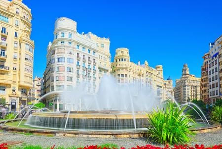 Valencia, Spain - June 13, 2017 : Fountain on Modernism Plaza of the City Hall of Valencia, Town hall Square (Modernisme Plaza of the City Hall of Valencia Placa de l Ajuntament).