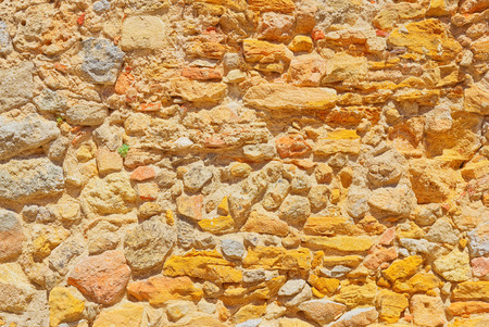Texture of rock wall in old Spanish city. Stok Fotoğraf