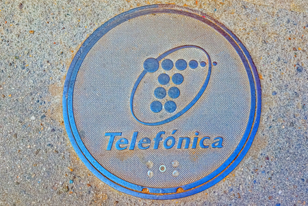 Seville, Slain- June 09, 2017 : Sewage telephone hatch with the inscription of the telecommunications company of Spain - Telefonica.