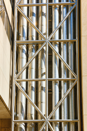Pipes of ventilation or water coming along the wall of the building.USA.