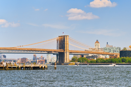 Suspended Brooklyn Bridge across the East River between the Lower Manhattan and Brooklyn. New York, USA.