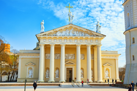 Vilnius, Lithuania - April 12, 2018: St. Stanislaus Cathedral on Cathedral Square with Monument to Grand Duke Gediminas in the historic part of the old city of Vilnus.