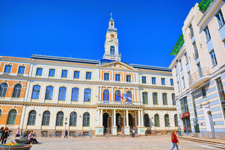 Riga, Latvia - April 12, 2018: Town Hall Square (Latvian Ratslaukums) is one of the central squares of Riga, located in the Old Town.