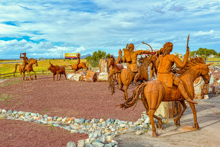 Arizona, USA - September 18, 2018: Statues, sculptures of iron metalwork near the cafe Stones&More in Arizona.