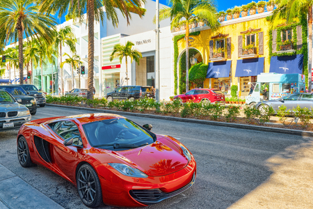 Los Angelos, California, USA - September 23, 2018: Beautiful and expensive sports cars on fashionable street Rodeo Drive in Hollywood.