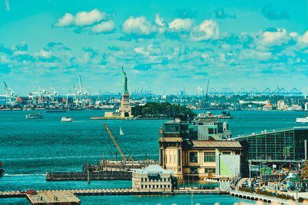 View of Manhattan and Brooklyn Bridge across the East River between Manhattan and Brooklyn. New York, USA.