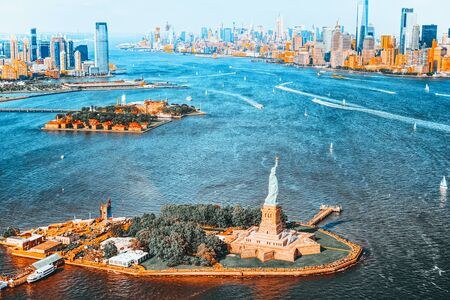Fly over, view Statue of Liberty (Liberty Enlightening the world) near New York and Manhattan from a birds eye view.