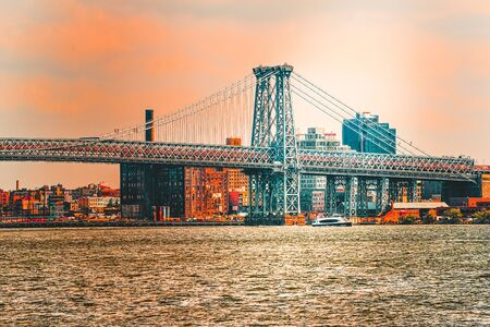 New York view of the Lower Manhattan and the Williamsburg Bridge  across the East River. USA.  Фото со стока