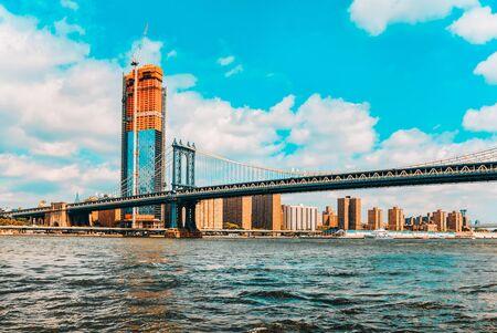 New York view of the Lower Manhattan and the Manhattan Bridge across the East River. USA. Фото со стока