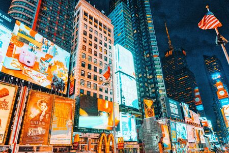 New York, USA- September 06, 2017 : Night view of Times Square-central and main square of New York. Street, cars, people and tourists on it. 스톡 콘텐츠