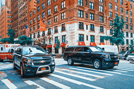 New York, USA- September 05, 2017 : Urban cityscape of New York. Midtown district. Street, cars, people and tourists on it.