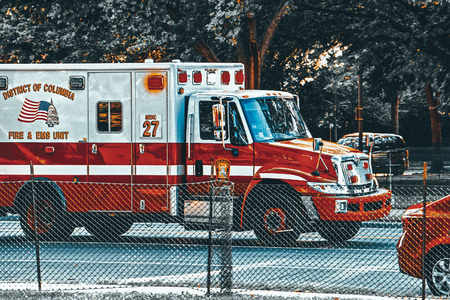 Washington, DC, USA - September 10,2017 : Ambulance ( Emergency) car  and  urban cityscape of Washington. Editorial