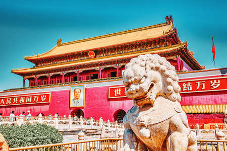"BEIGING,CHINA- MAY 18, 2015: Gate of Heavenly Peace- peoples on entrance to the Palace Museum in Beijing.Inscription-""Long live the People's Republic of China! Long live the solidarity of the peoples of the world!"".Tiananmen Square is a third large city s"