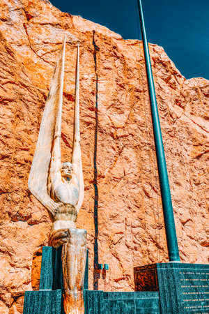Famous and amazing Hoover Dam at Lake Mead, statue of flag, USA.