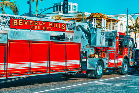 Los Angelos, California, USA - Beverly Hills area and fire trucks, hurry to fire.
