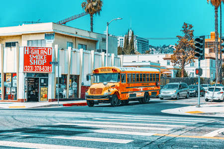 Los Angelos, California, USA - September 04, 2018:Famous American yellow school buses on the streets. Editorial