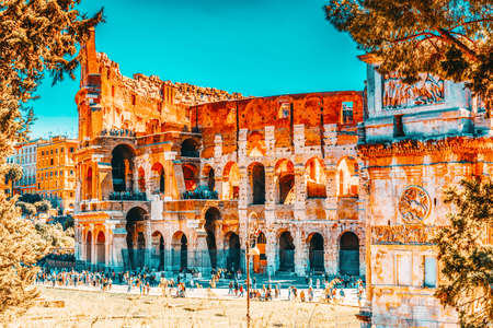 ROME, ITALY - MAY 08, 2017 : Beautiful landscape of the Colosseum in Rome- one of wonders of the world  in the morning time with tourists near him. 版權商用圖片