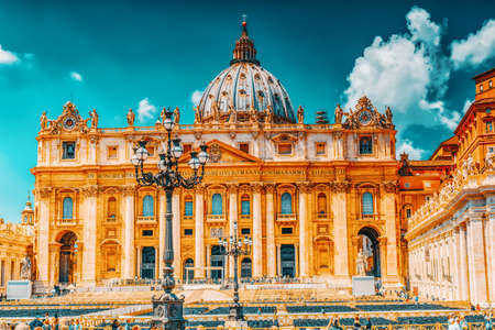 VATICAN-CITY, VATICAN-MAY 09, 2017 : St. Peter's Square and St. Peter's Basilica, Vatican City in the day time, tourist around. Italy.