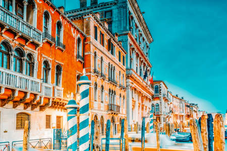 Views of the most beautiful canal of Venice - Grand Canal water streets, boats, gondolas, mansions along. Night view. Italy.